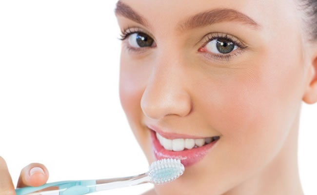 Exfoliate Gently using a Toothbrush
